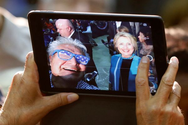 A supporter takes a selfie with Democratic presidential candidate Hillary Clinton at East Los Angeles College in Los Angeles