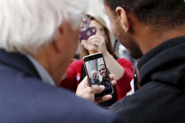 Democratic presidential hopeful Bernie Sanders takes a selfie with a voter on primary election day in Philadelphia on&nb