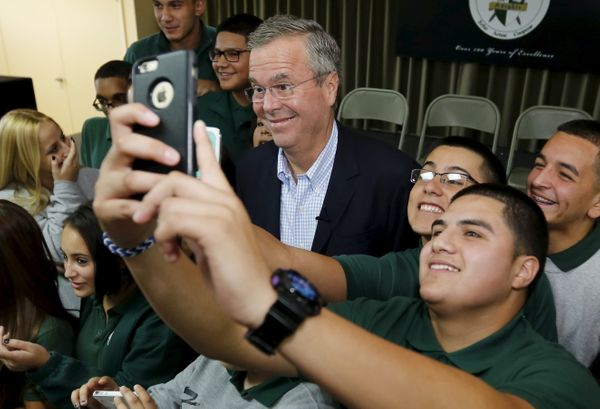 Former Florida Gov. Jeb Bush poses with a student following a town hall with high school students at La Progresiva Presb