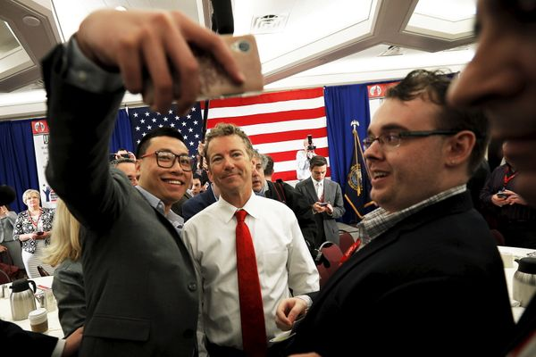 Sen. Rand Paul (R-Ky.) poses for a selfie with an audience member after speaking at the First in the Nation Republican L