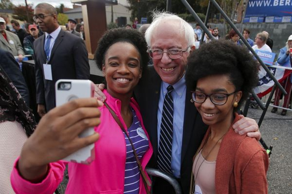 Democratic presidential hopeful Bernie Sanders takes a selfie with supporters after a campaign rally at the South Caroli