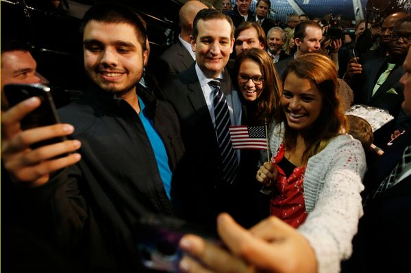 "Sen. Ted Cruz (R-Texas) poses for pictures with students shooting ""selfies"" after confirming his candidacy for the 2016"