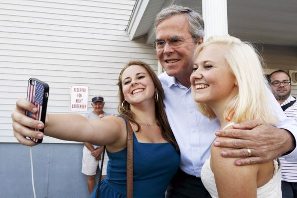 Former Florida Gov. Jeb Bush poses for a selfie before a VFW town hall event in Merrimack, New Hampshire, on August 19, 2015.
