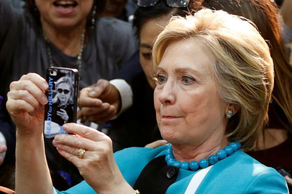 Democratic presidential candidate Hillary Clinton takes a selfie after speaking at East Los Angeles College in Los Angeles on