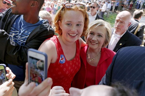 Democratic presidential candidate Hillary Clinton poses for a selfie with a supporter during a campaign event in Hanover, New