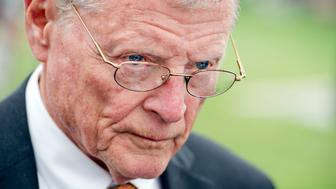 UNITED STATES - APRIL 15: Senate Environment and Public Works Committee Chairman James Inhofe, R-Okla., talks with reporters after a news conference at the senate swamp on the importance of a long-term surface transportation bill, April 15, 2015. (Photo By Tom Williams/CQ Roll Call)