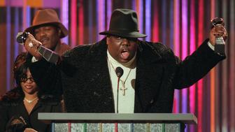 """**FILE**Notorious B.I.G., who won rap artist and rap single of the year, clutches his awards at the podium during the Billboard Music Awards in New York, in this Dec. 6, 1995 file photo. On Friday, Nov. 16, 2007, a wrongful death lawsuit brought by the family of slain rapper Notorious B.I.G. against the city of Los Angeles may be amended to include several other defendants, including record executive Marion """"Suge"""" Knight, a federal judge has ruled. The rapper, whose real name was Christopher Wallace, was shot and killed March 9, 1997, after a party at the Petersen Automotive Museum in Los Angeles.(AP Photo/Mark Lennihan, File)"""
