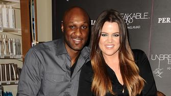 ORANGE, CA - JUNE 07:  Lamar Odom and Khloe Kardashian make a personal appearance for 'Unbreakable Bond' at Perfumania on June 7, 2012 in Orange, California.  (Photo by Jason LaVeris/FilmMagic)