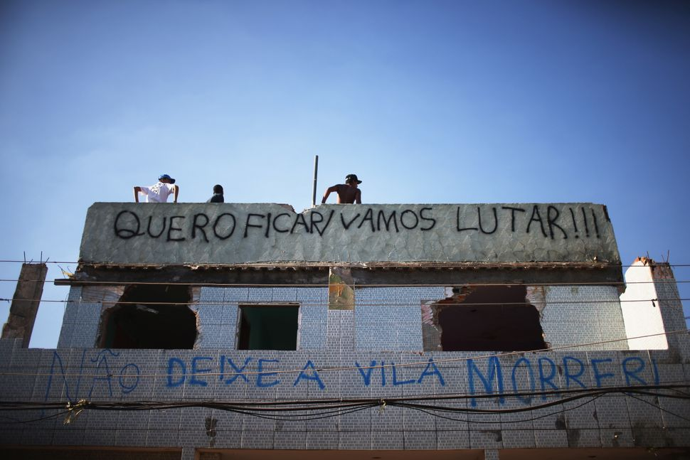 Families in Rio's Vila Autódromo favela have protested the demolition of their homes for Olympics-related constru