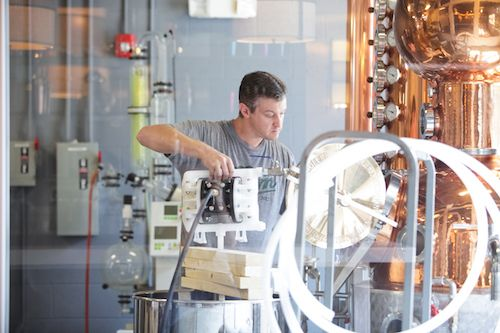 """Lee Katrincic is head distiller atDurham Distillery in Durham, North Carolina. The distillery makes Conniption""""American Dry"""" and """"Navy Strength"""" gins, as well as a line of liqueurs."""