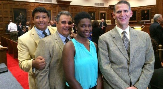 Michael De Leon, second from left, and Greg Bourke, far right, are seenwith their children in 2014. De Leon and Bourke