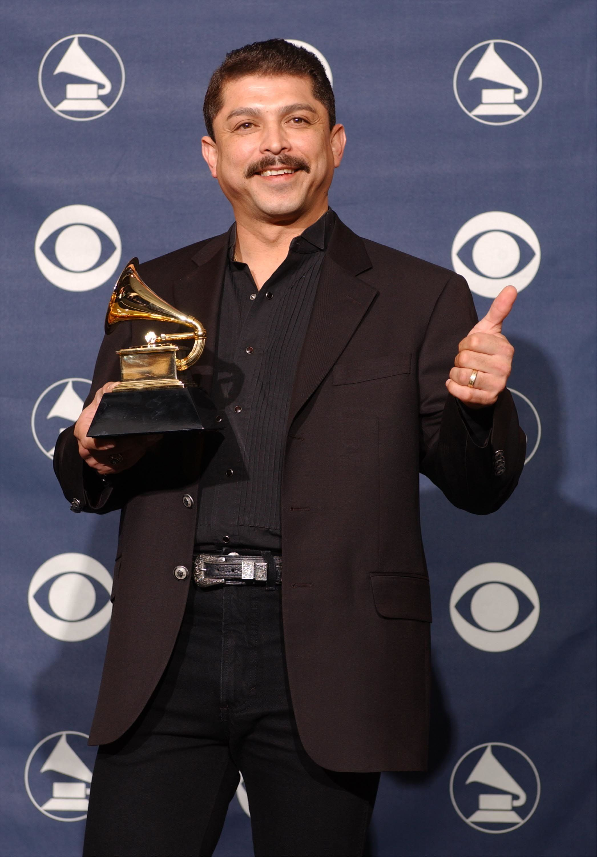 NEW YORK - FEBRUARY 23:  Winner for Best Tejano Album for 'Acuerdate', Emilio Navaira poses backstage at the 45th Annual Grammy Awards Pre-Telecast at Madison Square Garden on February 23, 2003 in New York City.  (Photo by Mark Mainz/Getty Images)