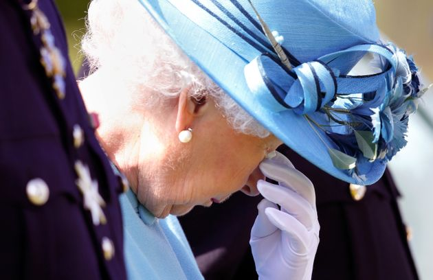 Queen Elizabeth II sheds a tear at an unveiling of a new