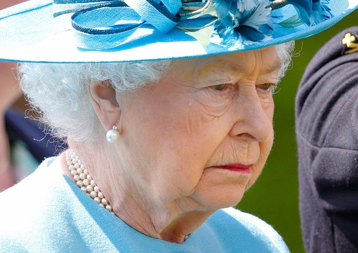 Queen Elizabeth II sheds a tear at the unveiling of a new memorial.