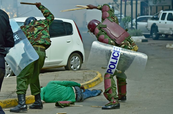 Kenyan security forces were captured on camera beating an unresponsive man lying in the street at a protest on Monday. T