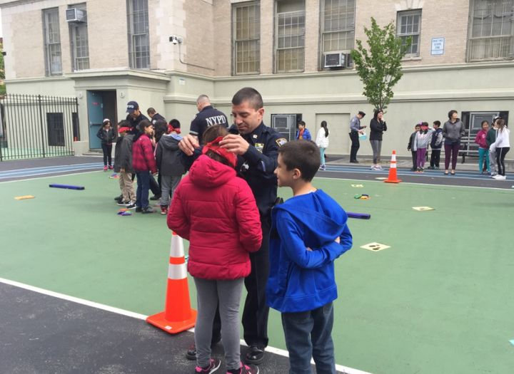 Police officers spent time at elementary schools around New York City on Tuesday to help encourage positive relatio