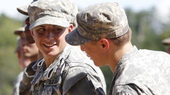 Capt. Kristen Griest of Orange, Connecticut (L) and 1st Lt. Shaye Haver of Copperas Cove, Texas chat as they wait to receive their ranger tabs at Ranger school graduation at Fort Benning in Columbus, Georgia August 21, 2015.  The two pioneering women made history on Friday as they became the first females to graduate from the Army's elite and grueling 62-day Ranger school, at Fort Benning, Georgia. Though Haver and Griest are still not eligible to take part in front-line combat, according to reports, a decision on whether to change that policy could come in the fall.. REUTERS/Tami Chappell