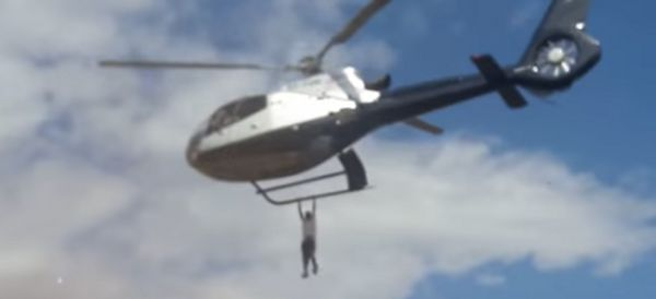 Man Hangs On To Helicopter Carrying Dead Man To Funeral