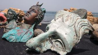 Artefacts from a merchant ship that sank off the ancient Mediterranean port of Caesarea 1,600 years ago are presented to the press by Israel's Antiquities Authority on May 16, 2016. The find, happened upon by two divers a few weeks ago who then alerted the authority, consisted primarily of 'metal slated for recycling' borne on the ship from Caesarea in the late Roman period, IAA experts said. / AFP / JACK GUEZ        (Photo credit should read JACK GUEZ/AFP/Getty Images)