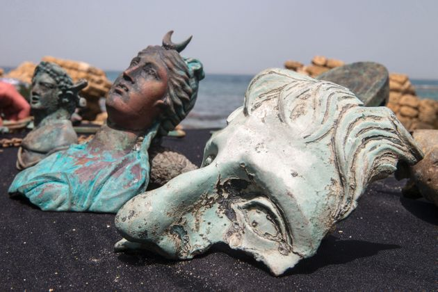 Two recreational divers happened upon a trove of ancient relics dating back about 1,600