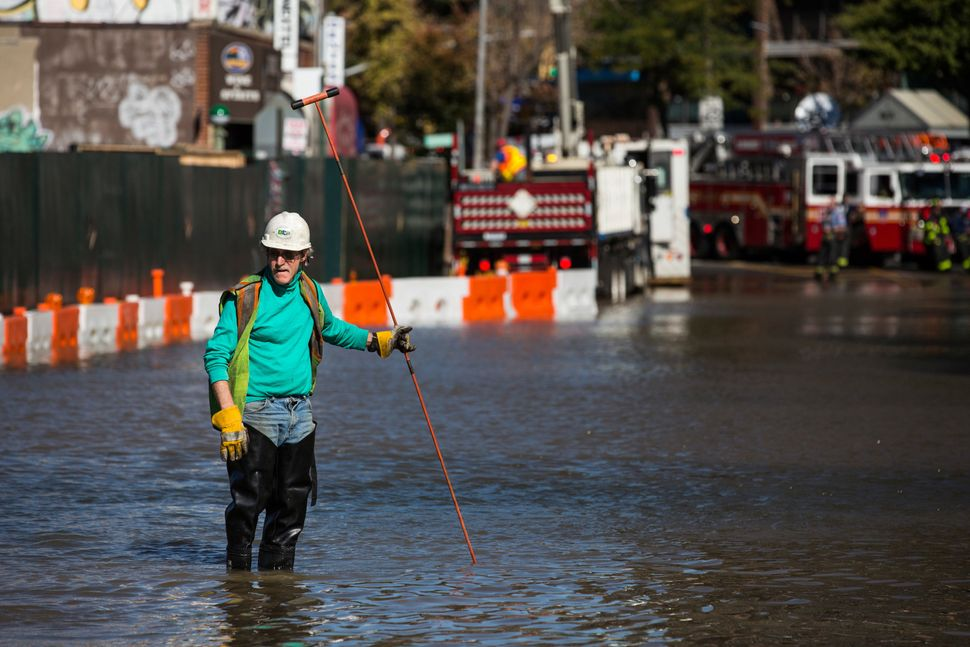 A first responder from at the site of a water main break in the Queens borough ofNew York City in October 2015.
