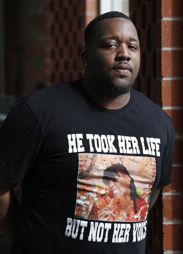 In this Friday, March 4, 2016 photo, Martinez Sutton wears a shirt commemorating his sister, Rekia Boyd, 22, who was shot and