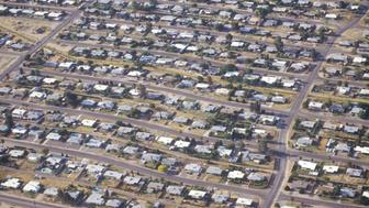 Aerial view of desert suburban homes in Tucson, Arizona (Photo by Visions of America/UIG via Getty Images)