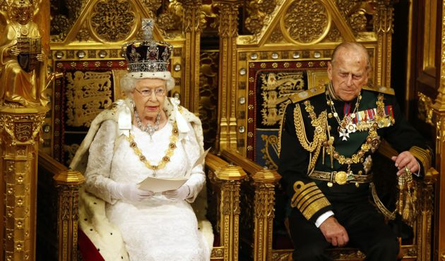 Queen Elizabeth II reads the Queen's Speech as Prince Philip listens during the State Opening of Parliament...