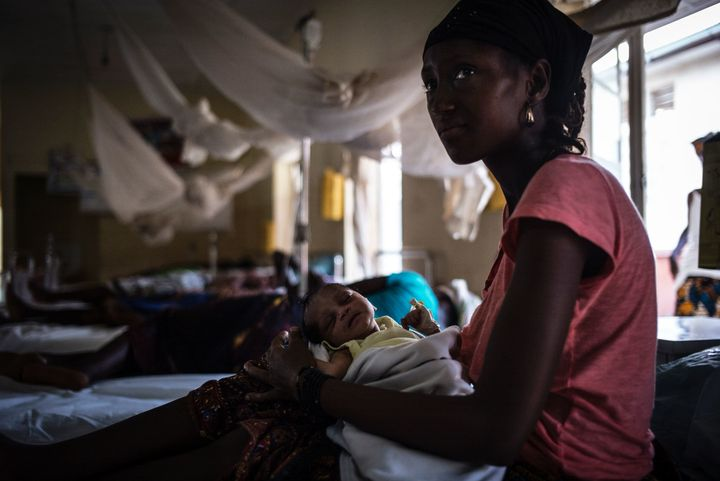 A mother nurses her newborn at the maternity ward of the Kailahun Government hospital ineastern Sierra Leone.