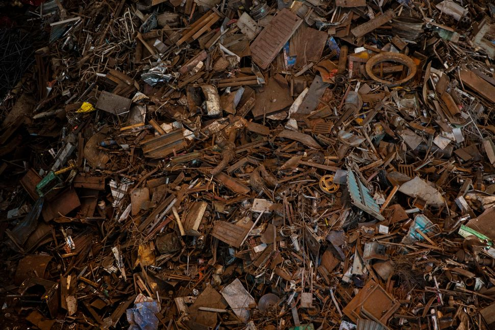 Scrap metal to be used for steel production is piled up.