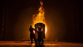 CHANGZHOU, CHINA - MAY 12:  A worker takes samples for quality of molten iron outside a furnace at the Zhong Tian (Zenith) Steel Group Corporation on May 12, 2016 in Changzhou, Jiangsu. Zhong Tian (Zenith) Steel Group Corporation is a privately-owned manufacturer that employs over 13,000 workers at its facility in China's eastern Jiangsu province. Since 2001, the company says it has adopted new technology to streamline the production of premium quality steel and to reduce environmental impact. The majority of its steel output is for the Chinese market with 20% earmarked for export, mostly to Asia. The company says it is profitable, but admits business has dropped marginally from past years. China is the world's largest steel producer, accounting for over 50% of global supply. China's government has vowed to cut production capacity at state-owned enterprises by up to 150 million tonnes over five years to ease concerns of an oversupply on global markets. However, its efforts appear to be overshadowed by a recent increase in steel prices that has revived production at some Chinese facilities that had been closed down.  (Photo by Kevin Frayer/Getty Images)