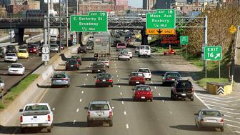 388964 01: Commuter traffic makes it way along Interstate 93 May 8, 2001 in Boston MA. According to a study by the Texas Transportation Institute, 1.2 million people drive into Boston for work each day. (Photo by Darren McCollester/Newsmakers)