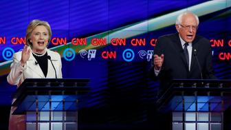 Democratic U.S. presidential candidates Hillary Clinton (L) and Senator Bernie Sanders speak simultaneously during a Democratic debate hosted by CNN and New York One at the Brooklyn Navy Yard in New York April 14, 2016.  REUTERS/Lucas Jackson (TPX IMAGES OF THE DAY)