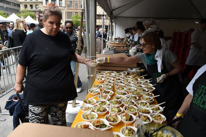 Woman getting some grub at the 'Feeding the 5000 NYC' in Union Square Park.