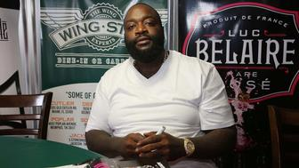 DEERFIELD BEACH, FL - MAY 26: Rick Ross meets and greets fans at Wing Stop on May 26, 2014 in Deerfield Beach, Florida. (Photo by Aaron Davidson/WireImage)
