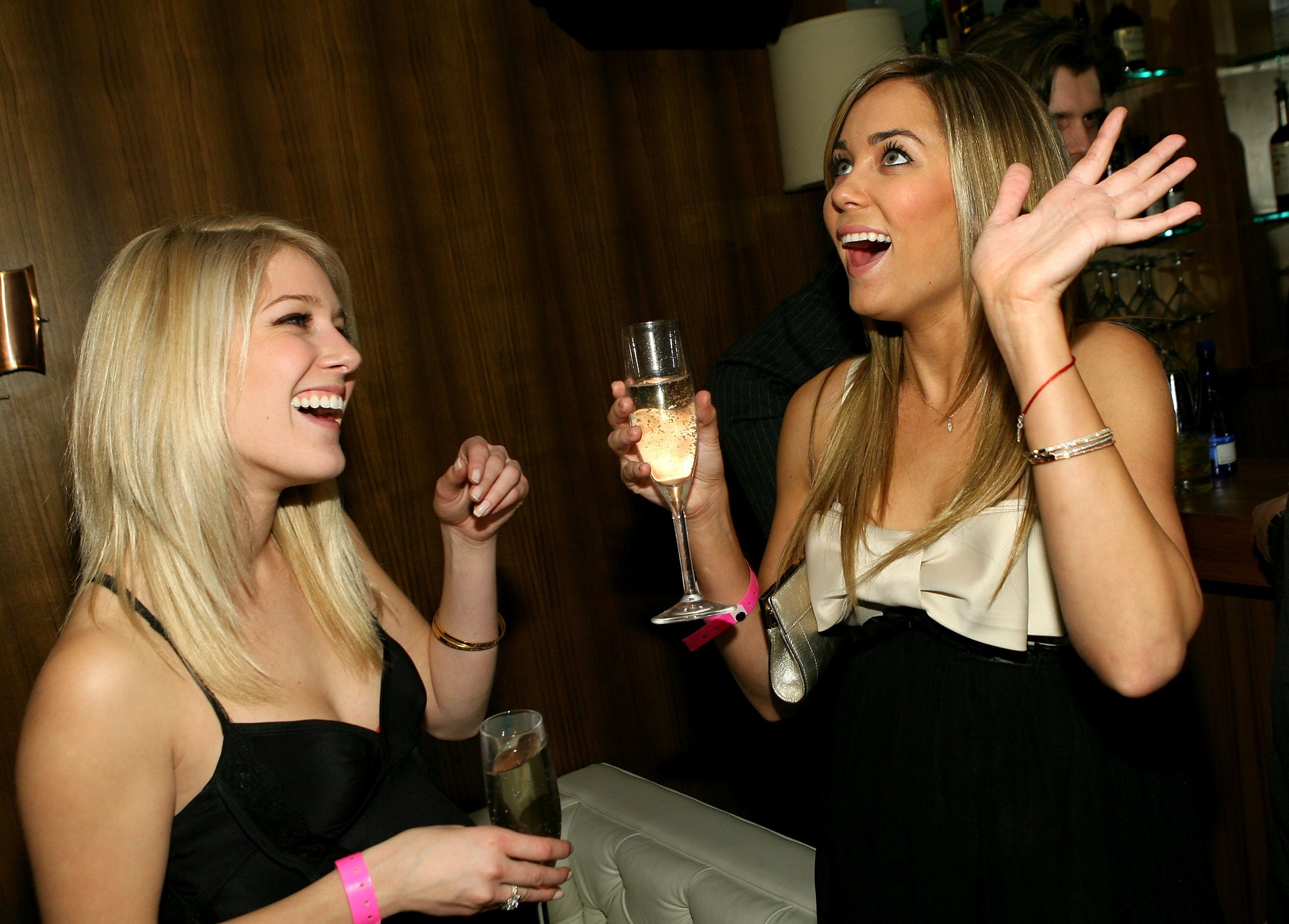 WEST HOLLYWOOD, CA - FEBRUARY 01:  ***EXCLUSIVE ACCESS***  Heidi Montag and Lauren Conrad toast to champagne as mark. celebrates new spokesperson Lauren Conrad's 21st birthday at Area on February 1, 2007 in West Hollywood, California.  (Photo by Michael Buckner/Getty Images for mark.)