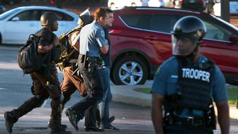 Ryan Reilly is arrested in Ferguson Mo. on Aug. 13, 2014.