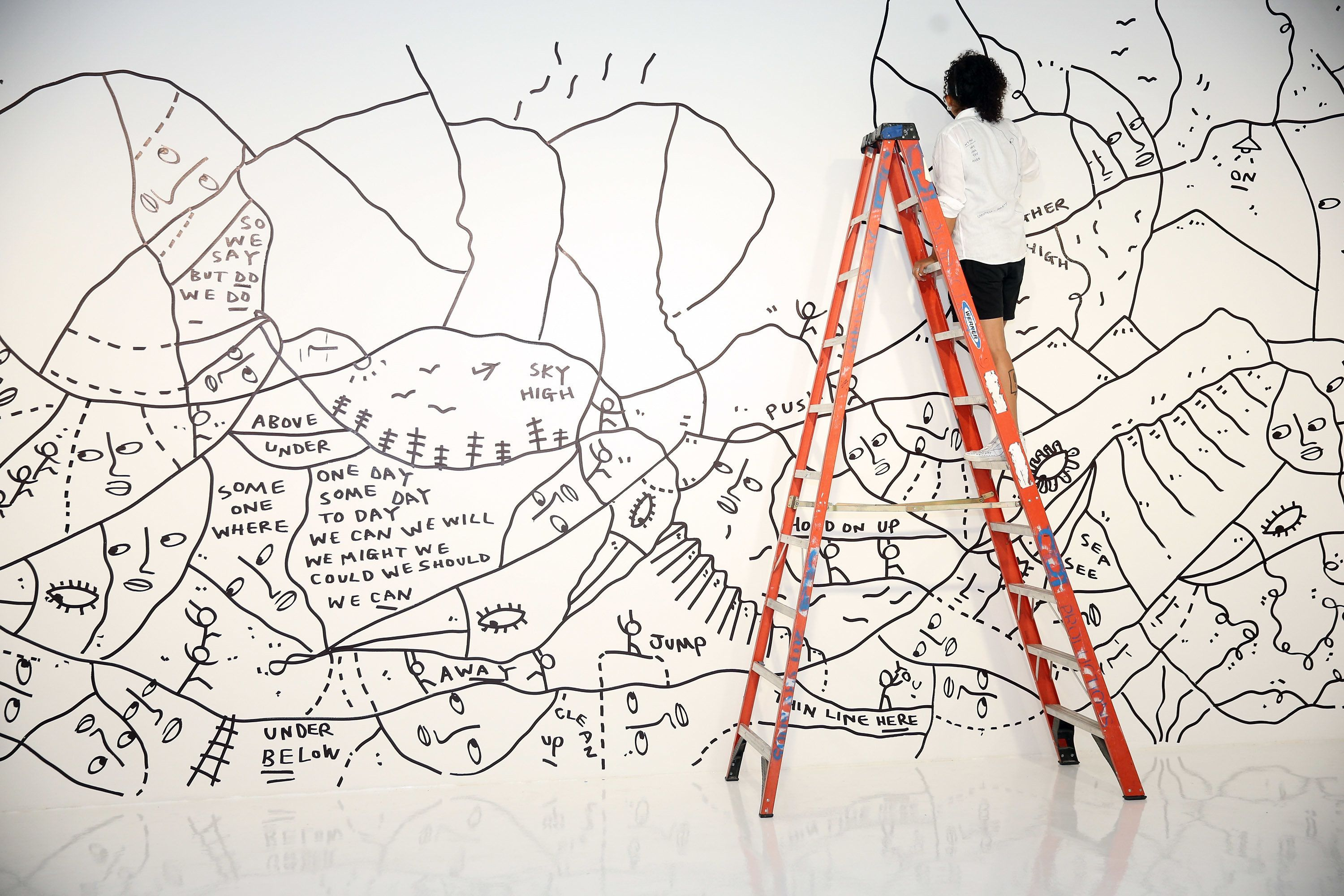 NEW YORK, NY - SEPTEMBER 09:  Artist Shantell Martin completes her mural installation before the start of Spring 2016 New York Fashion Week: The Shows at Skylight Clarkson Sq on September 9, 2015 in New York City.  (Photo by Neilson Barnard/Getty Images for NYFW: The Shows)