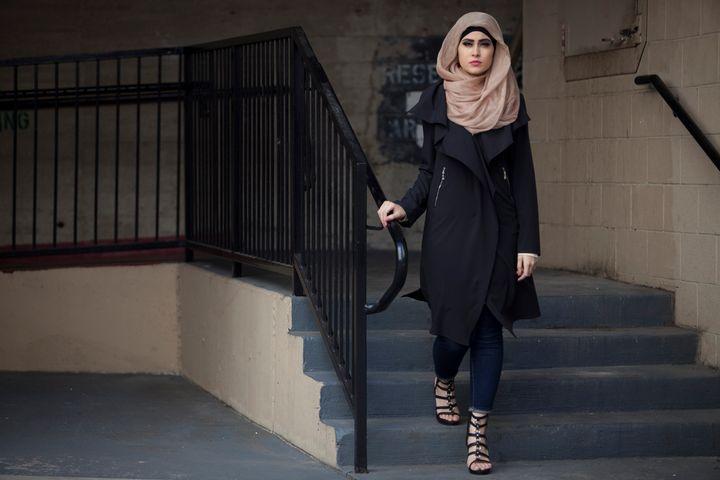 Model Sarah Al Ramahi wears a Verona Collection cardigan.