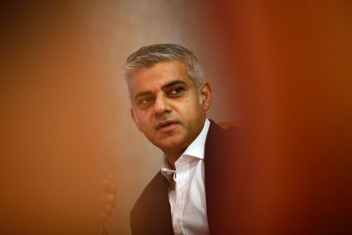 London mayoral candidate Sadiq Khan gestures during an interview with Reuters at Canary Wharf in London, Britain November 17,