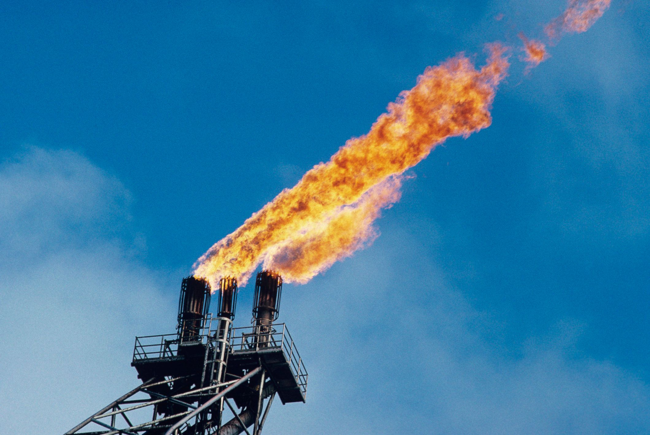 Offshore oil platform; 'burn off'  oil fume flames, low angle view