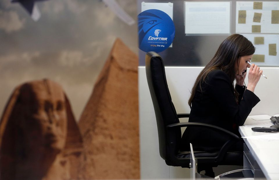 An employee works at the EgyptAir desk at Charles de Gaulle airport after news of the disaster