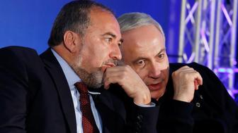 Israel's Prime Minister Benjamin Netanyahu (R) converses with former Foreign Minister Avigdor Lieberman during a Likud-Yisrael Beitenu campaign rally in the southern Israeli city of Ashdod January 16, 2013. REUTERS/Amir Cohen/File Photo