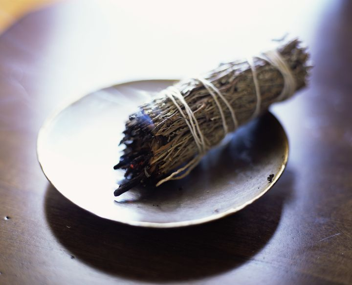 The smoke from sage or incense can be clearing, according to Scher.