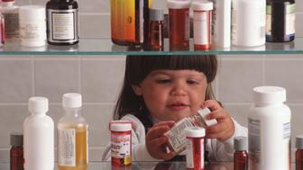 health,medicine,horizontal,child,girls,young,medicine,cabinet,pills,drugs,jars,bottles,shelves,playing,prescriptions,pharmaceuticals,person,opening,holding,kids,persons,people,