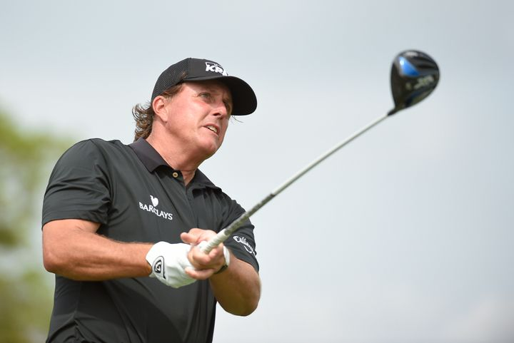 Phil Mickelson follows his drive off the 11th tee box during first round of the Cadillac Championship at TPC Blue Monster at