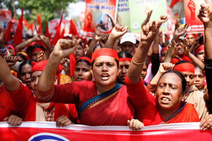 Bangladeshi garment workers attend a rally, demanding their rights including safety, a minimum monthly salary, and equal sala