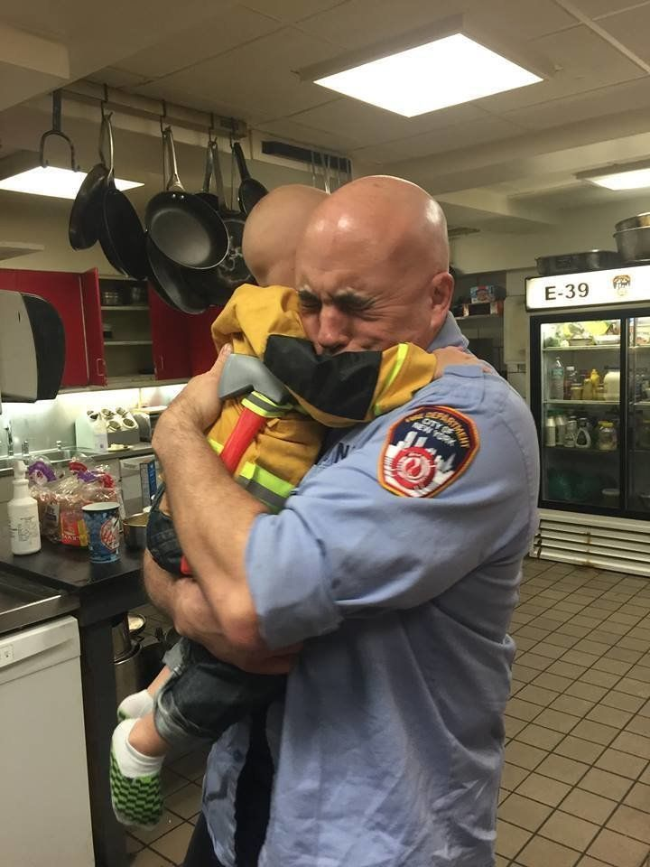 This photo of Trucker Dukes hugging FDNY Captain Jim Grismer prompted the boy's invitation to become an honorary firefighter of New York.