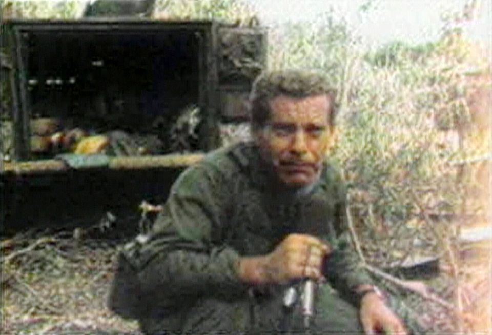 CBS News correspondent Morley Safer crouches to avoid hostile fire as he reports from Vietnam in 1965. Image is a screen grab