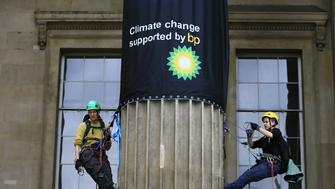 Greenpeace activists climb the British Museum in protest at BP's sponsorship of a new exhibition 'Sunken Cities'. The climbers unfurl seven huge banners down the front columns of the British Museum. The banners carry the names of cities and regions struck by flooding and climate change disasters.